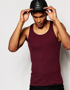 "Vest by ASOS Soft-touch jersey Ribbed finish Scoop neck Slim fit - cut closely to the body Machine wash 100% Cotton Our model wears a size Medium and is 188cm/6'2"" tall"