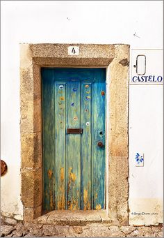 Old painted door in a ancient house in the medieval town of Marvão, Alentejo, Portugal