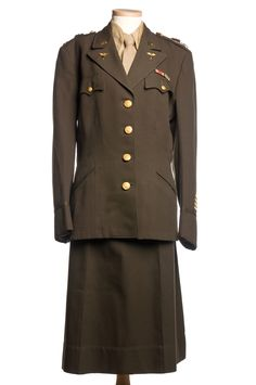 "Army Nurses Corps Uniform: circa 1939-1945. ""This uniform was worn by Miss Ruth Chamberlin who served in North Africa, Italy, France, and England. She was Chief Nurse of the Army's Third General Hospital and was later the Dean of the School of Nursing in Charleston."""