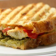Grilled Chicken Panini with Roasted Red Peppers, Pesto and Garlic Herb Cheese.  Pioneer Woman.