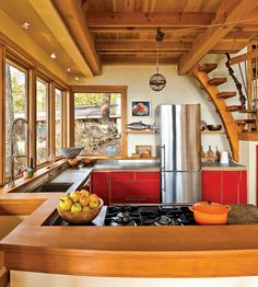 Cool cabin kitchen - loft bedroom right above it.