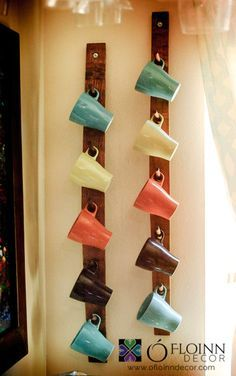 mug storage rack.. this looks better than all the heavy boards and shelves nailed to the wall.. less weight.. Do several of these. Love it!