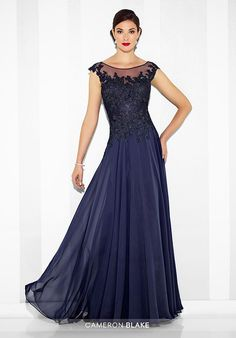 Chiffon and lace A-line gown with scalloped lace illusion cap sleeves and bateau neckline, hand-beaded lace bodice, illusion back with keyhole. Matching shawl included.