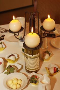Keep old wine bottles and stick on your own, custom label.  Add a wine bottle candelabra and you have a great #centerpiece.  We made these for the Highland Homes 2011 Sales Awards Banquet.