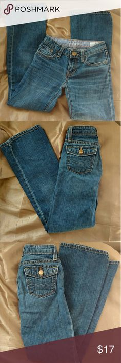 Gap jeans Like new condition!! No signs of wear.. Dark denim with three pockets in front and two back pockets with buttons. Gold stitching detail. Gap kids 1969 boot cut size 10 slim from a smoke and pet free home. Gap Bottoms Jeans