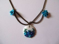 Blue flower patterned medal #clay
