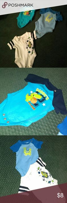 3 onesie bundle. 3 onesies, these are actually a thicker material than the basic white ones that come in packs. Great for warm weather or cold cuz u can throw a long sleeve onesie under these or not and wear a hoodie over or whatever u please! 2 are new without tags, just washed. And the other was worn once. 2 have button on side of neck to pull over baby's head easily and other had 2 buttons on chest no flaws great condition One Pieces