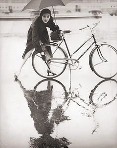 Model Anne St Marie photographed in the rain by her husband, Tom Palumbo, 1950s