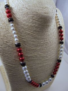 Check out this item in my Etsy shop https://www.etsy.com/listing/219069213/red-white-and-black-glass-pearl-necklace