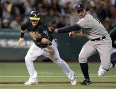 GAME 93: Friday, July 20, 2012 - New York Yankees third baseman Alex Rodriguez, right, tags out Oakland Athletics' Eric Sogard in a rundown between third base and home plate in the eighth inning of a baseball game in Oakland, Calif.