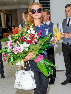Flowers, a cocktail 'n' chic cat eye-inspired sunnies? A shady Paris Hilton touched down in Poland with quite the welcome wagon!