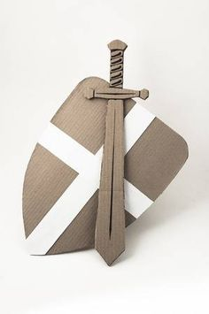photo of medieval sword and shield made of cardboards. this decorations are made specially for this photosession by me Cardboard Sword, Cardboard Forts, Cardboard Costume, Cardboard Crafts, Projects For Kids, Diy For Kids, Crafts For Kids, Carton Diy, Knight Costume