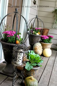Lovely spheres add architectural detail to a porch when plantings aren't as abundant in autumn.