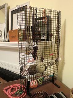 Remember Heron from her DC rowhouse tour? Well, here's her $10 DIY solution for keeping jewelry organized... and a cute kitty photo bomb.