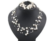 Multi Strands White Freshwater Pearl Set ( Necklace and Matched Bracelet )-----US$ 12.73