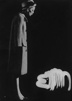 March Vogue 1962    Black and white four sided hounds-tooth coat, in checked wool tweed by Marc Bohan of Dior.