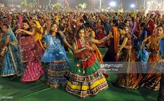Girls take part in Garba dance on the first day of Navratri festival near Madan Mahal garden on September 25, 2014 in Indore, India. Hindu festival of Navratri is observed twice a year, once in the beginning of summer and again at the onset of winter. Navratri means nine nights during which nine forms of Goddess/ Shakti/Devi are worshiped.