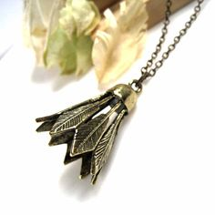 Antique Brass Badminton Shuttlecock Pendant Necklace. $12.00, via Etsy.