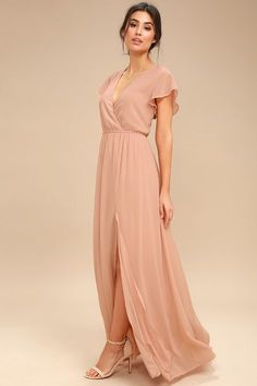 The romance of the Lost in the Moment Blush Maxi Dress will sweep you off your feet! A short sleeved, surplice bodice tops a maxi skirt.