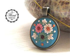 Boho Jewelry Turquoise Boho Necklace Blue Bohemian Necklace Turquoise Cabochon Necklace Spring Flower Pendant Polymer Clay Applique Jewelry This is a boho style, handmade, polymer clay turquoise pendant with flower motifs. This beautiful bohemian style necklace is a piece of