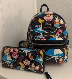 lightly used Loungefly Disney Alice in wonderland through the looking glass mini backpack and matching wallet set Wallet has some fading. Please look at all pictures. Queen of hearts. Cute Mini Backpacks, Stylish Backpacks, Girl Backpacks, Disney Handbags, Disney Purse, Purses And Handbags, College Bags For Girls, Disney Luggage, Mini Mochila