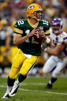 Aaron Rodgers Photos - Aaron Rodgers of the Green Bay Packers scrambles in the second quarter while taking on the Minnesota Vikings on September 2008 at Lambeau Field in Green Bay, Wisconsin. - Minnesota Vikings v Green Bay Packers Packers Gear, Go Packers, Packers Football, Football Memes, Greenbay Packers, Football Season, Green Bay Packers Cheesehead, Green Bay Packers Jerseys, Green Bay Packers Merchandise