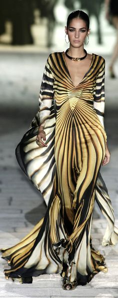 Roberto Cavalli. Love how it flows with air as she cat-walks. The dresses that flow are so beautiful. A designer drool!