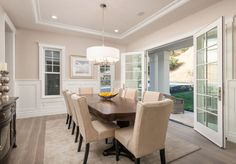 Dining room with French doors. Dining room with French doors. Dining room with French doors open to porch. #Diningroom #Frenchdoors The ADDRESS Company
