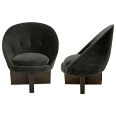 Pair of Swivel Egg Chairs on Cruciform Bases | From a unique collection of antique and modern lounge chairs at https://www.1stdibs.com/furniture/seating/lounge-chairs/