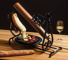 The secret to a delicious winter dinner party is fondue's cousin: ooey-gooey Alpine raclette.