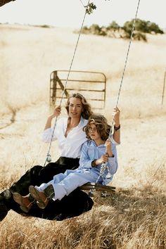 Tatjana Patitz and Jonah Patitz on a swing, photographed by Peter Lindbergh. Vogue 2011.
