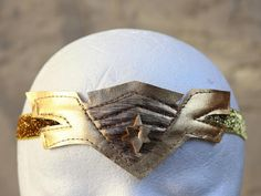 Wonder Woman headband handmade with golden felt. Handmade with love in a pet free, smoke free studio in USA. Wonder Woman Birthday, Wonder Woman Party, Kids Gifts, Baby Gifts, Tiara, Headbands For Women, Business Fashion, Accessories Shop, Birthday Party Themes
