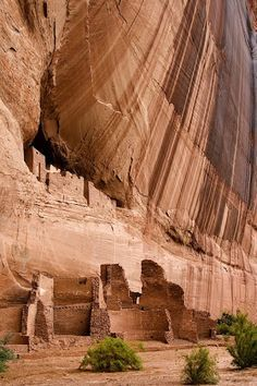 "White House Ruins, Canyon de Chelly, Arizona. White House Ruins stands out above lower ruins in a sandstone cave in Canyon De Chelly National Monument. These ruins were built by the Anasazi people. Anasazi is Navajo for ""the ancient ones."""