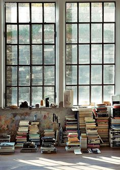vintage loft sporting a loose and spontaneous stack of books! //Manbo
