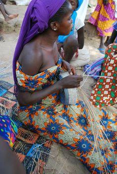 Woman artisans weaving baskets in Swaziland. Shop Artisan Connect.