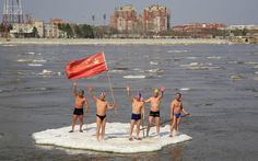 Winter swimmers wave on a piece of drifting ice with a Chinese national flag on the Amur River, in the Chinese border city of Heihe, Heilongjiang province May 6, 2013. (Photo by China Daily/Reuters) http://avaxnews.net/fact/The_Week_in_Pictures_May_6-May_10_2013.html #avaxnews.net