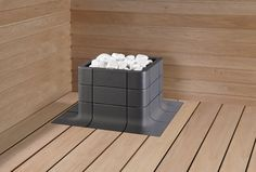 Nuoska integrated sauna heater in dark grey was introduced at Habitare. Google Image Result for http://www.tulikivi.fi/kuvat/kuvap/sauna/DECO_NUOSKA_GRAFIITTI_INTEGROITU_VALKOISET_KIVET_rgb.jpg