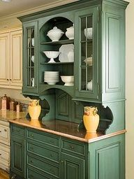 I'm really digging this green for an accent wall of cabinets in the kitchen!
