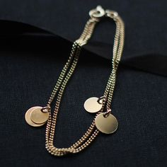 bellissima  gold coin bracelet by elephantine by elephantine, $37.00