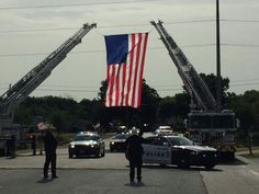 Dallas police officers lined up Saturday morning to salute the family of fallen Officer Patrick Zamarripa as they walked into his funeral.