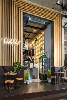 YUDIN Design have recently completed a TAKAVA, new coffee shop in Kiev, Ukraine, that features a warm wood facade with a view of the inside through large windows and an over-sized glass door. #ModernCoffeeShop #ModernCafe #WoodFacade