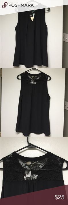 NWT black sleeveless top Sleeveless top has lace over shoulder and top back. One button in front with triangle peep hole. Blouse is light weight and fabric has a crepe feel to it. 100% polyester. Shoulder to hem measures 26 1/2 inches. Pit to pit measures 20 inches. Crescent Tops Blouses