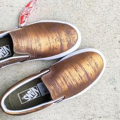Vans Brushed Bronze Metallic Slip-on Sneakers Grunge meets the original slip-on shoe from Vans with brushed metallic bronze upper. Topped with a padded ankle collar for added comfort along with a cushioned footbed + a rubber sole with signature waffle tread.  Content & Care - Leather, Cotton, rubber - Spot clean - Imported  Pics 2,3,1 photographed by me. Item's colour may vary from photos. Box has no lid  NO TRADES Vans Shoes Sneakers