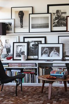 From AT: Layered Gallery Wall  I'd like to do this in the bedroom on the wall across from the foot of the bed.  A low white bookcase, layered with my photos...