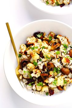 """This Roasted Cauliflower, Mushroom and Wild Rice """"Stuffing"""" is easy to make and full of the BEST savory flavors (plus a touch of sweet from those cranberries). It's also naturally gluten-free, vegetarianand vegan. Soit's the perfect dish that everyone can enjoy on Thanksgiving…or any day of the year! I think that this will officially be …"""