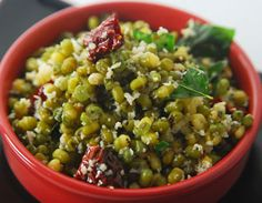 Green Gram Sundal Recipe - Cooked whole moong tempered with red chillies, green chillies, hing, curry leaves, urad dal and garnished with coconut.