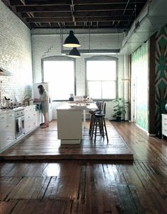 Contemporary meets heritage in this loft kitchen; with bright, hand-painted…