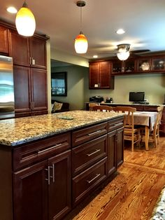 Kitchen remodel with oak floors, Giallo granite, SMART Cabinets Style: Atlantic, Color: Chestnut, Cosmas Satin Nickel drawer pulls from Amazon, Paint: Benjamin Moore Richmond Gray HC-96 predominant color with BM-HC 94 Old Salem Gray as accent wall.