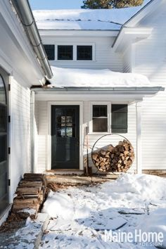 White house black door  New England Farmhouse in the snow (Maine Home + Design)