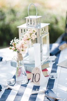 I loved all of the DIY. Not really a fan of the stripes, but the groomsmen's outfits were amazing and the centerpieces of  lanterns on old books was perfect. I also loved the flower girl's bouquet and the chalkboards that were cute, fun, and functional!
